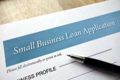 Small business loan application form. With pen stock photo