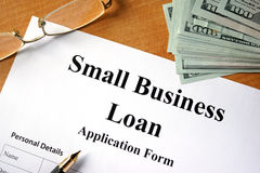 Small business loan form. Small business loan form on a wooden table Stock Photos