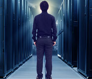 Small business man in data center. Small business man standing in big data center Royalty Free Stock Images