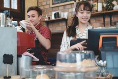 Small Business and Owner Business Concept. Young owner of coffee cafe service customer stock images