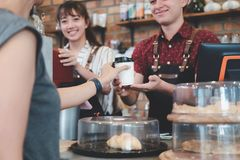 Small Business and Owner Business Concept. Young owner of coffee cafe service customer royalty free stock photography