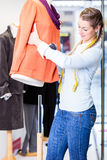 Small business owner dressing shop window stock photography