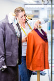 Small business owner dressing shop window Royalty Free Stock Images