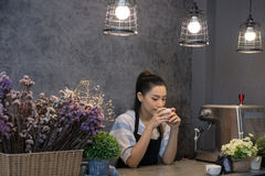 Small business owner at her coffee shop. happy asian woman stand Royalty Free Stock Photo