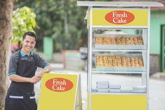 Small business owner and his food stall Stock Images