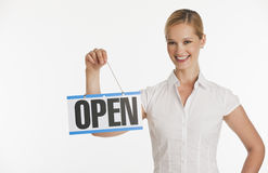 Small business owner holding up Open sign
