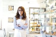 Small business owner portrait. Small business owner woman standing in bakery stock images