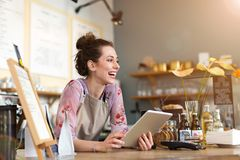 Young woman using digital tablet in coffee shop royalty free stock photo