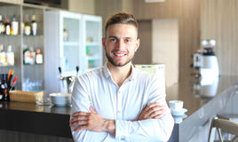 Small business owner. Working at his cafe stock photo