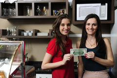 Small business: Owners of a cafe holding cash stock image