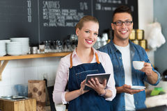 Small business owners in coffee shop Stock Images
