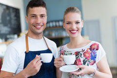 Small business owners in coffee shop Stock Image
