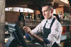 Free Small Business, People And Service Concept - Happy Man Or Waiter In Apron At Counter With Cashbox Working At Bar Or Royalty Free Stock Images - 155394189