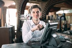 Free Small Business, People And Service Concept - Happy Man Or Waiter In Apron At Counter With Cashbox Working At Bar Or Stock Photo - 155743120