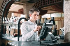 Free Small Business, People And Service Concept - Happy Man Or Waiter In Apron At Counter With Cashbox Working At Bar Or Stock Image - 155743171