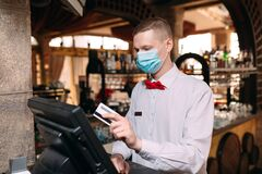 Free Small Business, People And Service Concept. Man Or Waiter In Medical Mask At Counter With Cashbox Working At Bar Or Stock Photos - 194631113