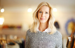 Small business. Portrait of designer woman standing in her clothing shop. Small business Stock Image