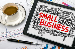 Small business with related word cloud handwritten on blackboard Royalty Free Stock Photo