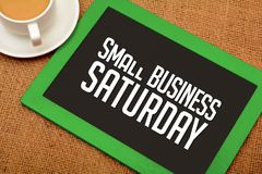 Small Business Saturday design on chalkboard with tea cup.  royalty free stock image