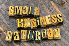 Small business saturday marketing sign. Commercial small business saturday retail store sales marketing sign letterpress letters block wood background typography royalty free stock photography