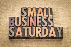 Small Business Saturday in wood type. Small Business Saturday word abstract - text in vintage letterpress wood type against burlap canvas, holiday shopping royalty free stock photo