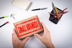 Small Business stamp. Courier delivered  box to the office Stock Image