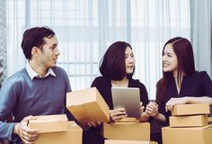 Small Business team checking stock in her online home busines royalty free stock images