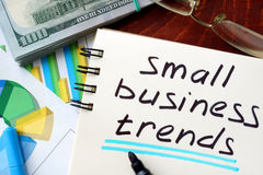 Small Business Trends. Small Business Trends written in a notepad. Business concept stock images