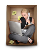 Small Business Woman in Office Box Stock Photography