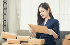 Small business woman preparing to send out her product in boxes stock photo