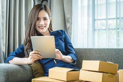 Small business woman preparing to send out her product in boxes royalty free stock photo