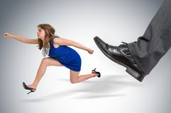 Small business woman running away from a boss pressure. Boss pressure concept royalty free stock photo