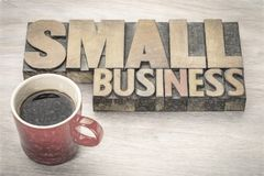 Small business word abstract in wood type. Small business word abstract in vintage letterpress wood type with a cup of coffee, charcho painitng digital effect royalty free stock images