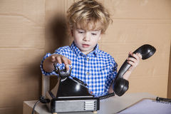 Small businessman dials the customer Stock Photo