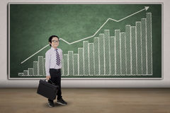 Small businessman and earnings graph Stock Photos