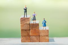 Small businessman figures standing on turning poing. royalty free stock photos