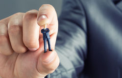 Small businessman in hand Royalty Free Stock Photo