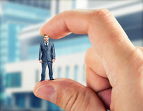 Small businessman in hand Stock Image