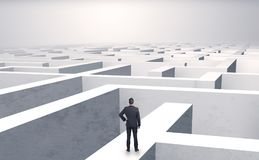 Small businessman in a middle of a maze Stock Photo