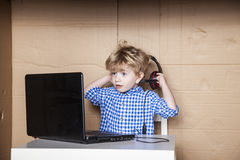Small businessman removes headphones Royalty Free Stock Photo