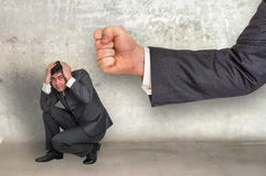 Small businessman under boss pressure Stock Photography