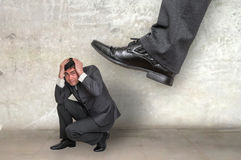 Small businessman under boss pressure Stock Images