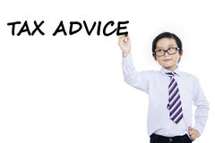 Small businessman writes tax advice. Cute little boy wearing business suit and write tax advice on whiteboard, isolated on white Royalty Free Stock Photography