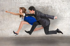 Small businesswoman and businessman running away Royalty Free Stock Photos