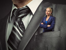 Small businesswoman in suit pocket Royalty Free Stock Images