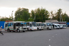 Small busses in a bus station Royalty Free Stock Photo