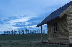 Small cabin facing sunset Royalty Free Stock Photo