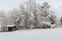 Small cabin in snow Royalty Free Stock Photos
