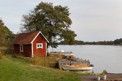 Small cabin standing on the lake Royalty Free Stock Photo