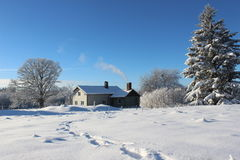 Small cabin in a winter landscape Royalty Free Stock Images